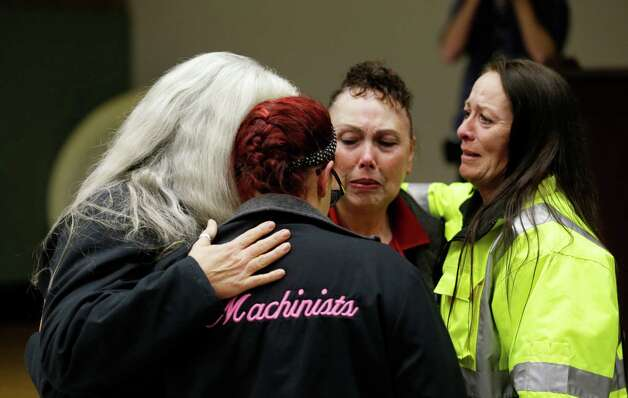 Boeing workers cry after learning that voters in District 751 of the Boeing machinists union voted to accept Boeing's latest contract offer to keep the assembly of the Boeing 777X airplane in Washington state, Friday, Jan. 3, 2014, in Seattle. Photo: Ted S. Warren, AP  / AP