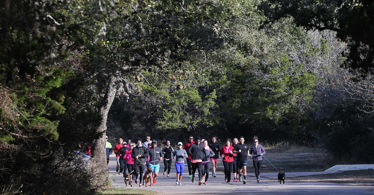 2. Police said Bump's death was a random killing, sparking fear in San Antonio's running community. Runners, joggers and walkers were urged to take a partner when out on public park trails. Pictured: Friends and supporters participate a one-mile silent run in memory of Lauren Bump at O.P. Schnabel Park, Sunday, Jan. 5, 2014.