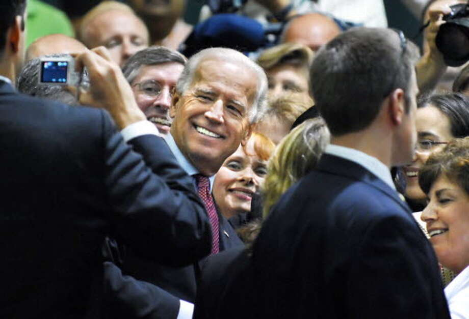 U.S. Vice President Joe Biden, center, poses for snapshots as he works the crowd at Shenendehowa High School in Clifton Park Thursday July 9, 2009, following a speech to highlight the work being done under the American Recovery and Reinvestment Act.(John Carl D'Annibale / Times Union)