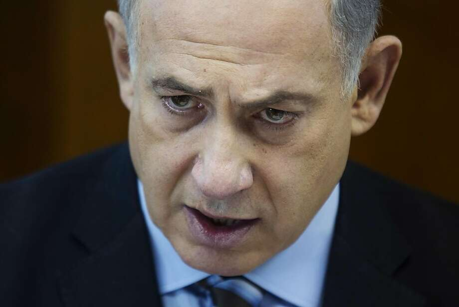 Israeli Prime Minister Benjamin Netanyahu speaks during a weekly cabinet meeting at his office in Jerusalem on Sunday, Jan. 5, 2014. (AP Photo/Abir Sultan, Pool) Photo: Abir Sultan, Associated Press
