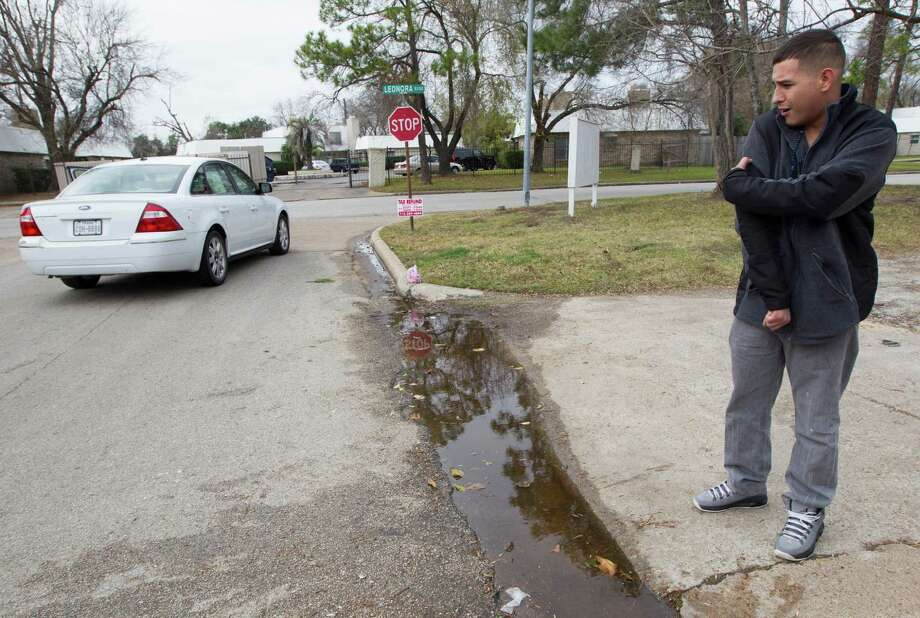 Gustavo Velasco stands at the scene where two female pit bulls killed a female victim around 2 a.m. on the corner of Glen Prairie and Leonora according to authorities on Sunday, Jan. 5, 2014, in Houston. Velasco was headed to the corner store with his friend Osby Pinles when they saw the victim.  Velasco attempted to alert neighbors as Pinles attempted to pull the pit bulls off the victim.  Pinles suffered minor injuries to his arms and legs. Photo: J. Patric Schneider, For The Chronicle / © 2014 Houston Chronicle