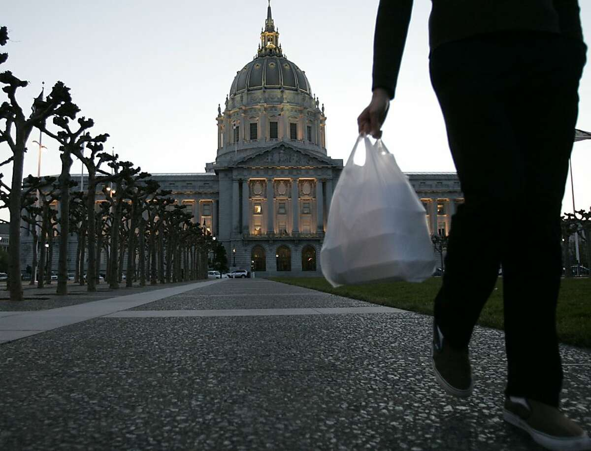 San Francisco City Hall is in the background where earlier today, March 27, 2007, the San Francisco Board of Supervisors voted to ban plastic bags at groceries and pharmacies, making SF the first city in the nation to pass such a ban. Photo by Michael Maloney / San Francisco Chronicle