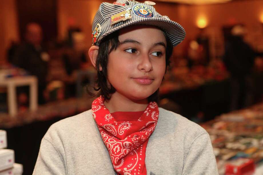 Riley Webb, 12, of Stratford helps out and shops at the Model Railroad, Train & Toy Show at the Marriott in Trumbull on Sunday, Jan. 5, 2014. Photo: BK Angeletti, B.K. Angeletti / Connecticut Post freelance B.K. Angeletti