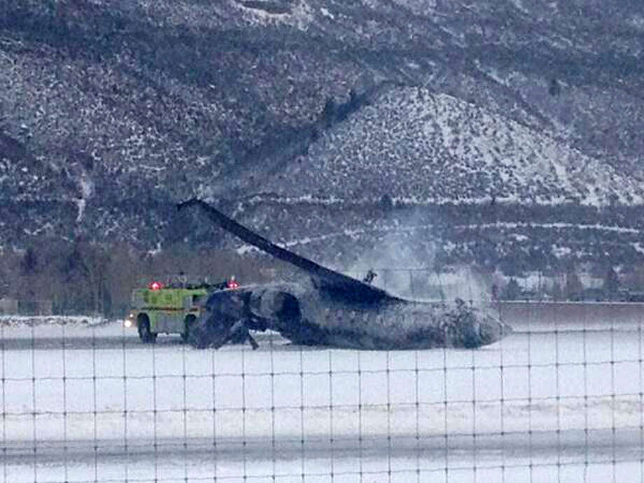 Emergency crews respond as a small plane lies on a runway at Aspen Airport in western Colorado after it crashed upon landing Sunday, Jan. 5, 2014. Emergency crews are responding to a fiery plane crash at Aspen Airport in western Colorado. Photo: Corey Morris-Singer, AP  / AP2014