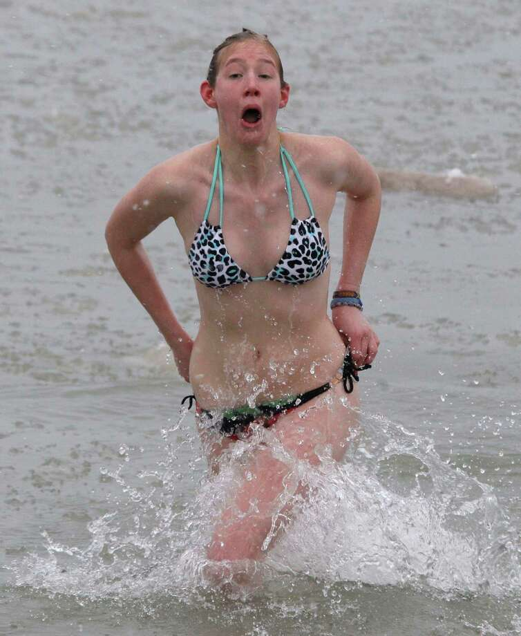 Kris Harmelink of Sheboygan exits the cold Lake Michigan waters at the Polar Bear dip, Wednesday, Jan. 1, 2014 in Sheboygan, Wis. (AP Photo/The Sheboygan Press, Gary C. Klein Photo: Gary C. Klein, AP  / The Sheboygan Press