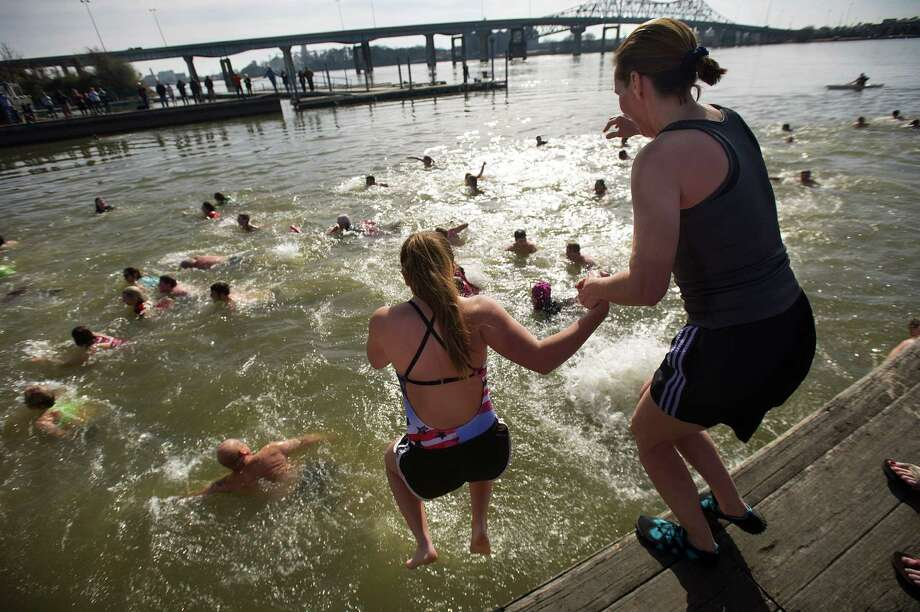 Swimmers brave the cold water for the Decatur Polar Bear Club's annual dip into the Tennessee River on Wednesday, Jan. 1, 2014. Photo: Brennen Smith, AP  / The Decatur Daily
