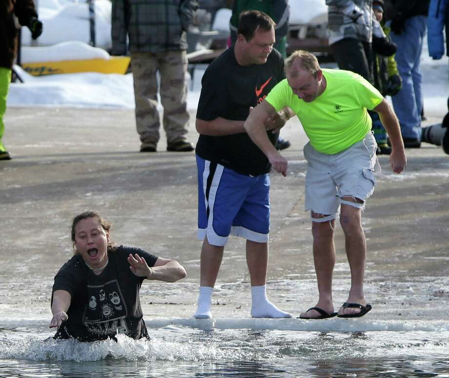 Waupaca Chain O' Lakes Polar Bear Plunge at Becker Marine on Lime Kiln Lake in Waupaca, Wis., Wednesday, Jan. 1, 2014 Photo: Wm. Glasheen, AP  / Post-Crescent Media