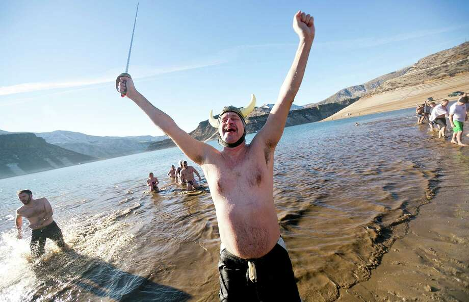 "Jacob ""Dr. J"" Neufeld, with the (St. Luke's Children's Hospital) Children's Rehab Warriors Team celebrates after exiting Lucky Peak Lake in Boise, Idaho during Make-A-Wish Idaho's 11th Annual Great Polar Bear Challenge, Wednesday, Jan. 1, 2014. At the time of the Great Polar Bear Challenge, water temperature was 33 degrees, air temperature was 34 degrees, and the wind chill was 27 degrees. Photo: Kyle Green, AP  / Idaho Statesman"