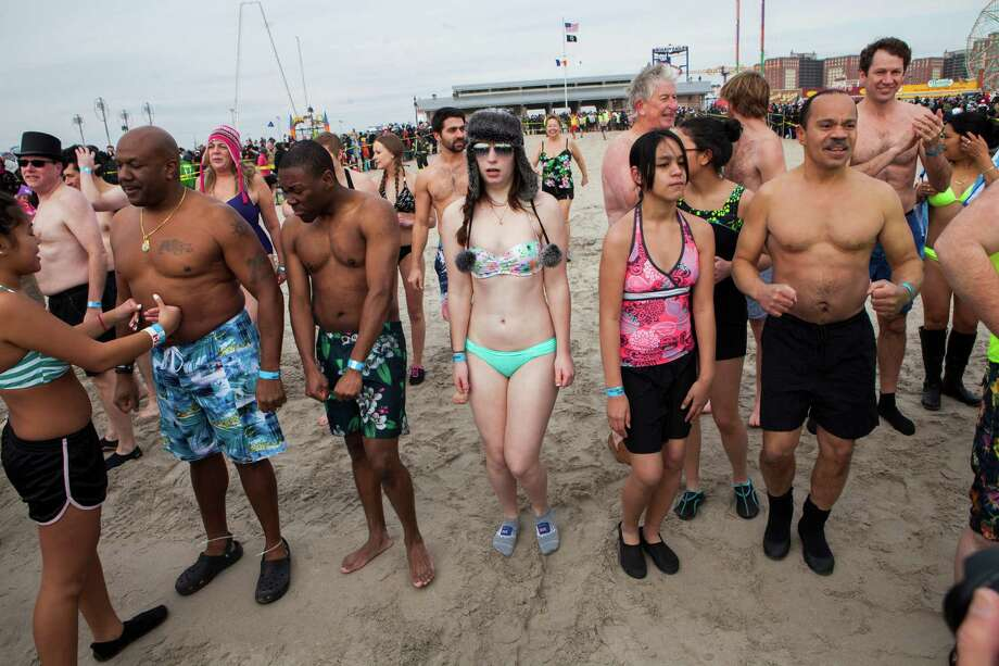 People wait to run into the water just off the Boardwalk January 1, 2014 at Coney Island in the Brooklyn borough of New York City. Hundreds of people gathered for the annual New Year's Day Polar Bear swim in the ocean. Photo: Christopher Gregory, Getty Images / 2014 Getty Images
