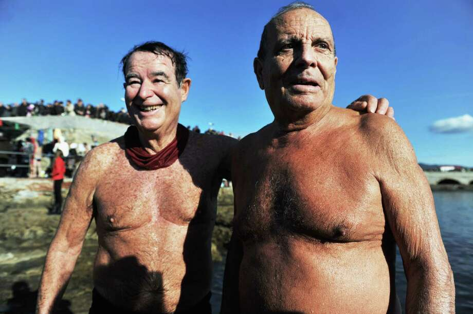Two swimmers over eighty-years-old take part in the 'New Year's Dip' (Tuffo di Capodanno) in the cold water of the Tyrrhenian Sea, on January 1, 2014 in Livorno, Italy. This year marked the 30th anniversary of the traditional New Year's Day dip, which this year attracted more than 200 swimmers. Photo: Laura Lezza, Getty Images / 2014 Laura Lezza