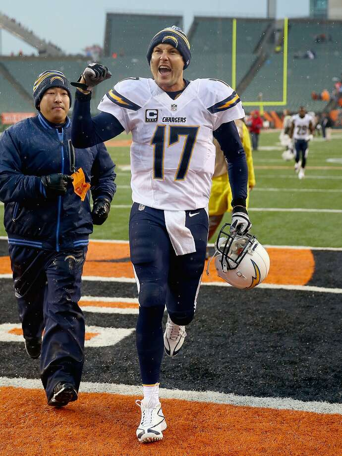 CINCINNATI, OH - JANUARY 05:  Philip Rivers #17 of the San Diego Chargers celebrates as he runs off the field after the NFL wild card playoff game against the Cincinnati Bengals at Paul Brown Stadium on January 5, 2014 in Cincinnati, Ohio.  (Photo by Andy Lyons/Getty Images) Photo: Andy Lyons, Getty Images