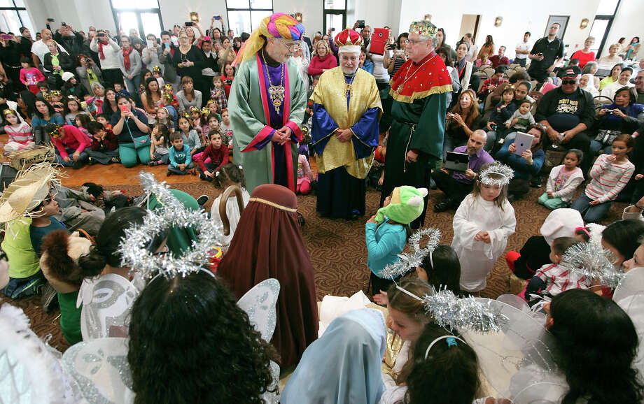 From left: Benigno Fernandez, Jose F. Pascual, and Jose Borrero as the Three Kings take part in a reenactment of the nativity during the Puerto Rican Heritage Society's Three Kings Day celebration held Sunday Jan. 5, 2014 at the AT&T Community Centre at San Fernando. Photo: Edward A. Ornelas, San Antonio Express-News / © 2014 San Antonio Express-News