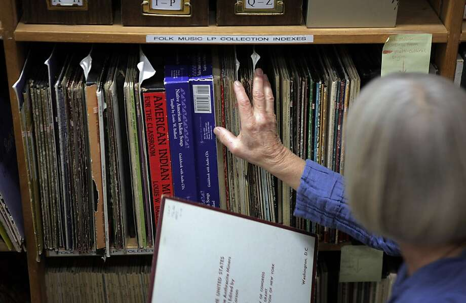 Anne Laskey, director of the Kodály Center for Music Education, shelves a reference item. Photo: Carlos Avila Gonzalez, The Chronicle