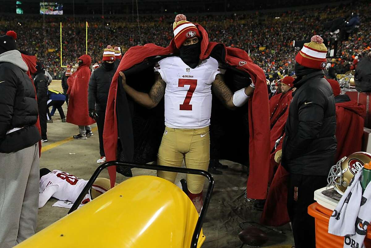 GREEN BAY, WI - JANUARY 05: Colin Kaepernick #7 of the San Francisco 49ers warms up on the sideline during their NFC Wild Card Playoff game against the Green Bay Packers at Lambeau Field on January 5, 2014 in Green Bay, Wisconsin. (Photo by Jonathan Daniel/Getty Images)