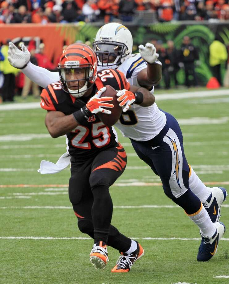 Chargers linebacker Donald Butler, right, chases down Bengals running back Giovani Bernard in the first half. Photo: Tom Uhlman, Associated Press