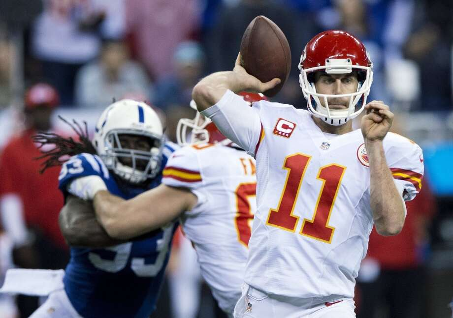 Chiefs quarterback Alex Smith (11) throws against the Colts as the pocket begins to collapse. Photo: John Sleezer, McClatchy-Tribune News Service