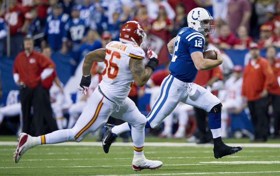Colts quarterback Andrew Luck (12) out runs Chiefs inside linebacker Derrick Johnson (56) for a first down. Photo: John Sleezer, McClatchy-Tribune News Service