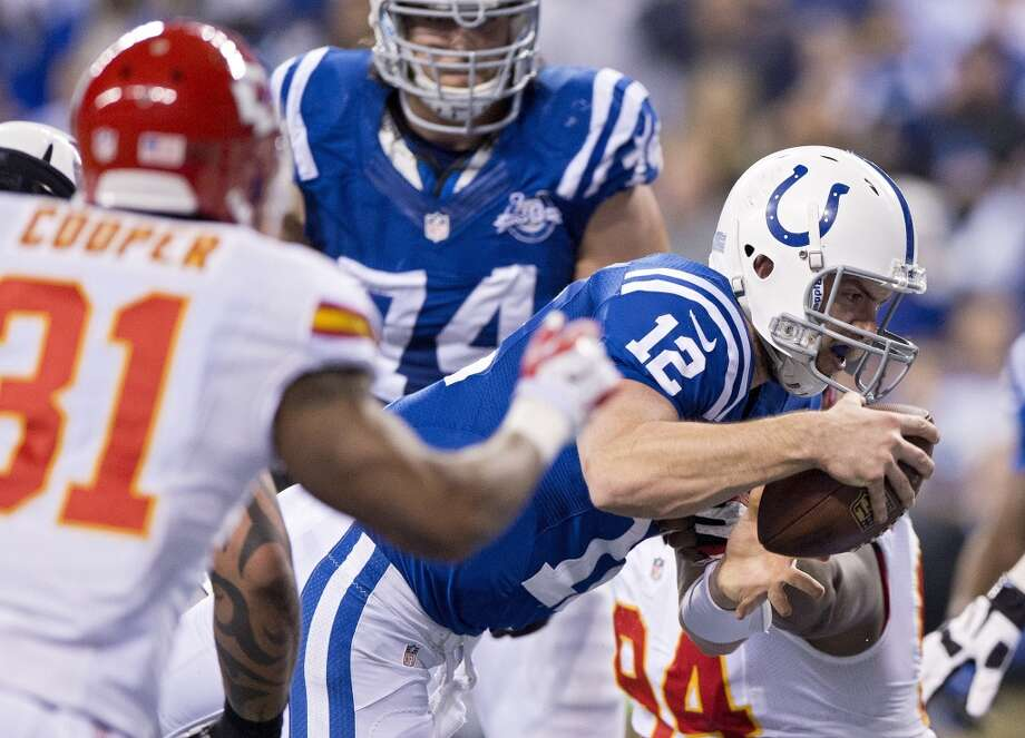 Colts quarterback Andrew Luck (12) leaps into the end zone after recovering a fumble. Photo: John Sleezer, McClatchy-Tribune News Service