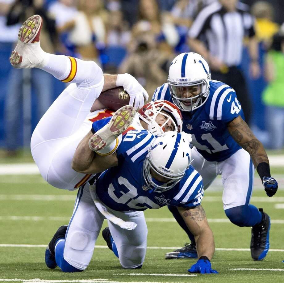 Chiefs tight end Anthony Fasano (80) is upended by Colts strong safety LaRon Landry. Photo: John Sleezer, McClatchy-Tribune News Service