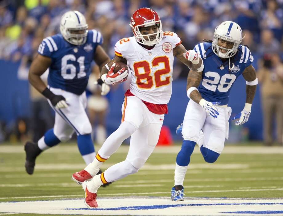 Chiefs wide receiver Dwayne Bowe (82) gaines 63 yards on a pass past Colts defensive tackle Jeris Pendleton (61) and Colts cornerback Greg Toler. Photo: David Eulitt, McClatchy-Tribune News Service