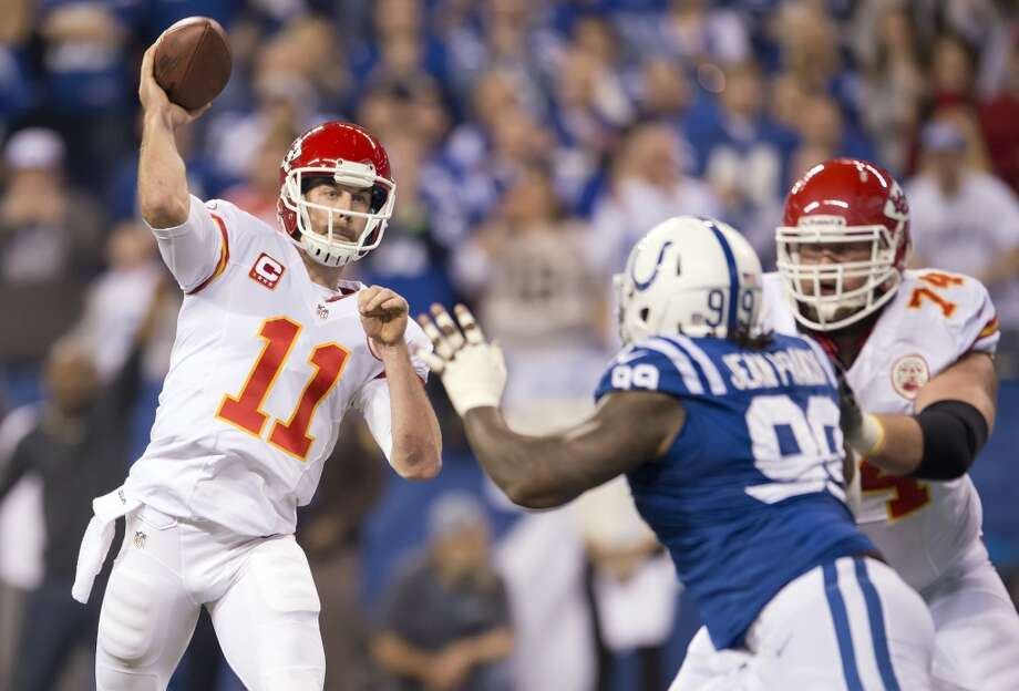 Chiefs quarterback Alex Smith (11) throw a pass for a touchdown over Colts defensive end Ricky Jean Francois. Photo: David Eulitt, McClatchy-Tribune News Service