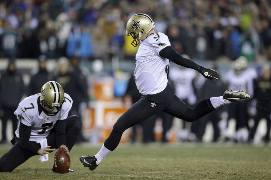 Shayne Graham kicks a field goal. Photo: Michael Perez, Associated Press