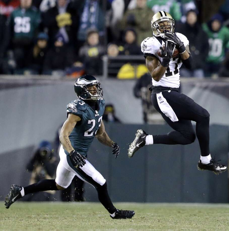Robert Meachem, right, catches a pass against Patrick Chung. Photo: Julio Cortez, Associated Press