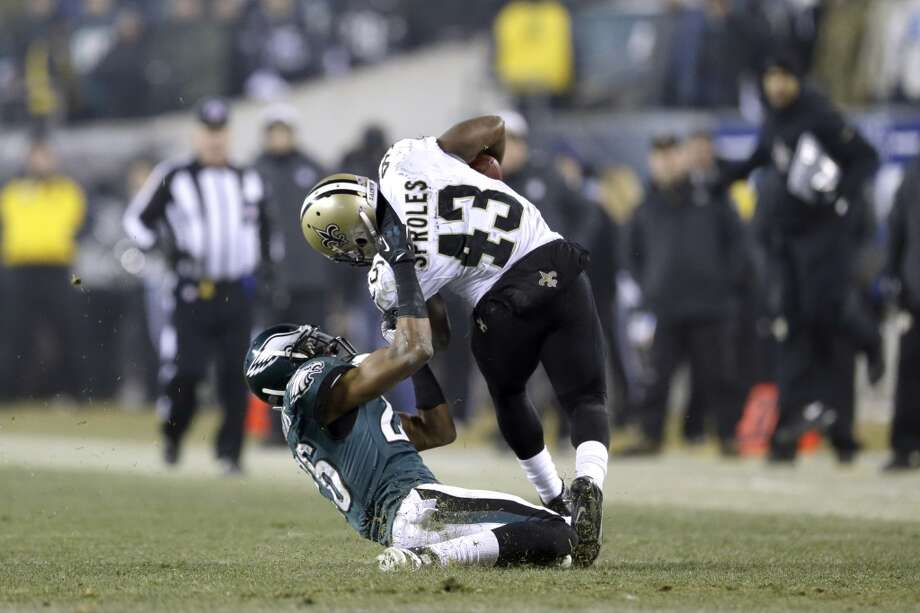 Darren Sproles (43) is tackled by Cary Williams. Photo: Julio Cortez, Associated Press