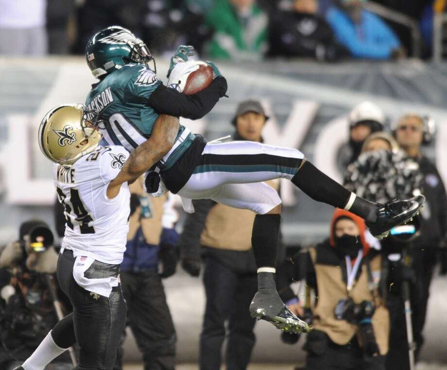 Eagles wide receiver DeSean Jackson makes a leaping catch in front of Saints cornerback Corey White for a 40-yard gain. Photo: CLEM MURRAY, McClatchy-Tribune News Service