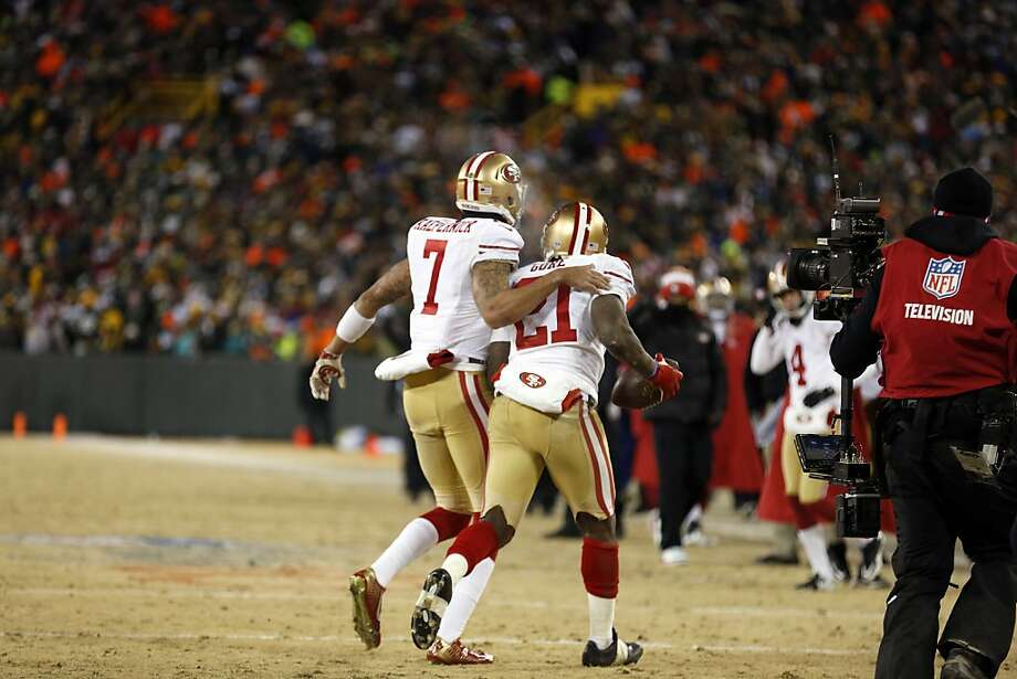 San Francisco 49ers running back Frank Gore (21) and San Francisco 49ers quarterback Colin Kaepernick (7) celebrate a touchdown during the first half of an NFL wild-card playoff football game against the Green Bay Packers, Sunday, Jan. 5, 2014, in Green Bay, Wis. (AP Photo/Jeffrey Phelps) Photo: Jeffrey Phelps, Associated Press