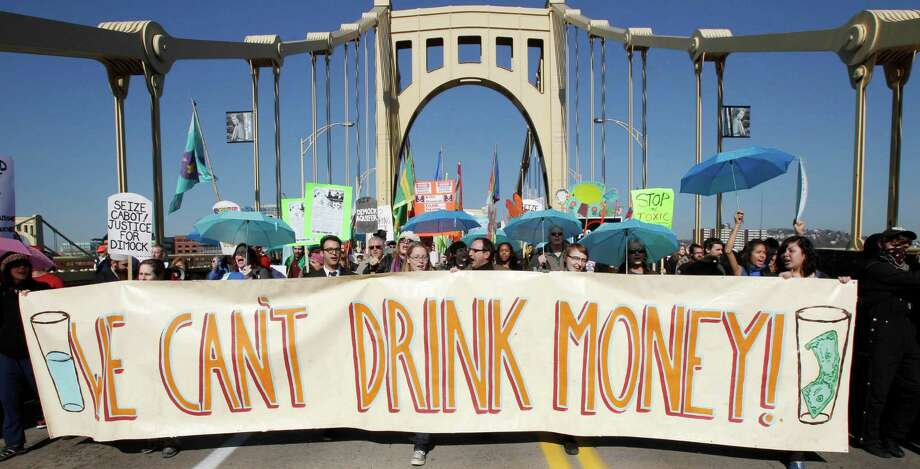 FILE- In this Nov. 3, 2010 file photo, marchers concerned with water pollution protest against hydraulic fracturing and gas well drilling as they cross the Rachel Carson Bridge on their way through town to the Developing Unconventional Gas (DUG) East convention and exhibition being held in Pittsburgh. Pennsylvania officials say there have been 370 complaints so far in 2013 alleging that oil or natural gas drilling polluted or diminished the flow of water to private water wells. But The Associated Press found that a lack of detail in the data make it almost impossible to judge whether the drilling boom is harming more individuals than in the past, or less. (AP Photo/Keith Srakocic, File) Photo: Keith Srakocic, STF / AP