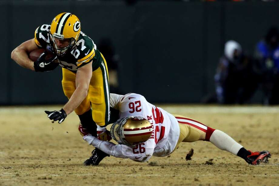 Jordy Nelson #87 of the Packers catches a pass against Tramaine Brock. Photo: Ronald Martinez, Getty Images