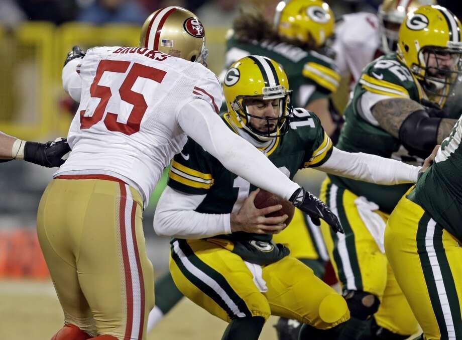 49ers outside linebacker Ahmad Brooks (55) sacks Packers quarterback Aaron Rodgers. Photo: Mike Roemer, Associated Press