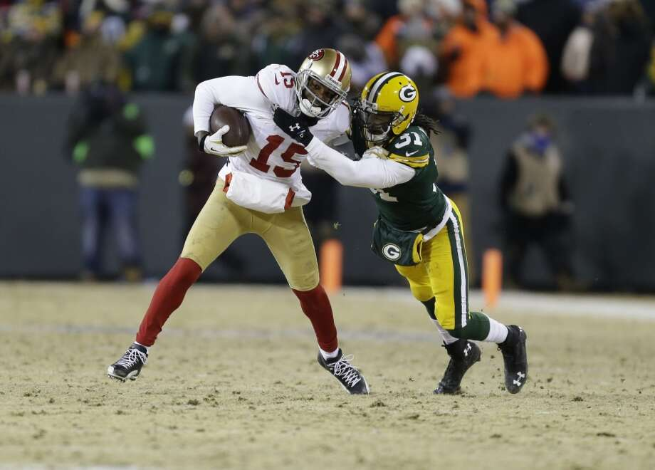 49ers wide receiver Michael Crabtree (15) runs against Packers cornerback Davon House (31) after catching a pass. Photo: Mike Roemer, Associated Press