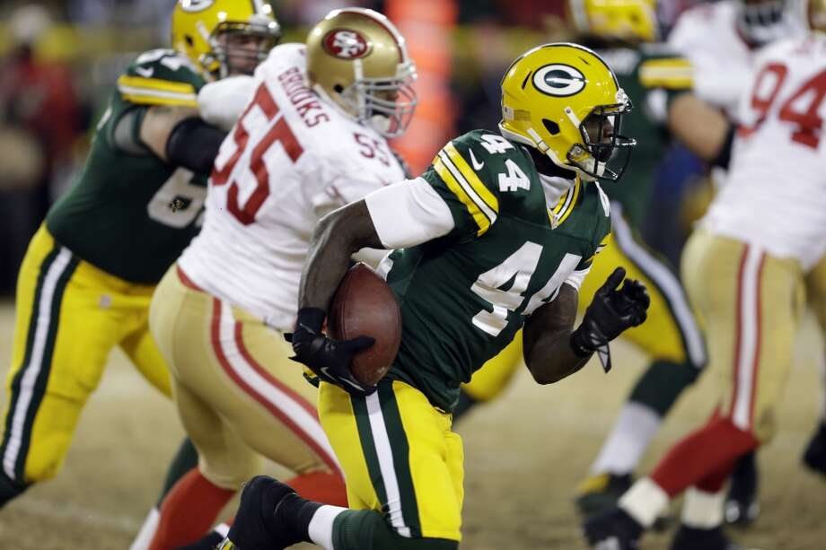 Packers running back James Starks (44) rushes against the 49ers defense. Photo: Mike Roemer, Associated Press