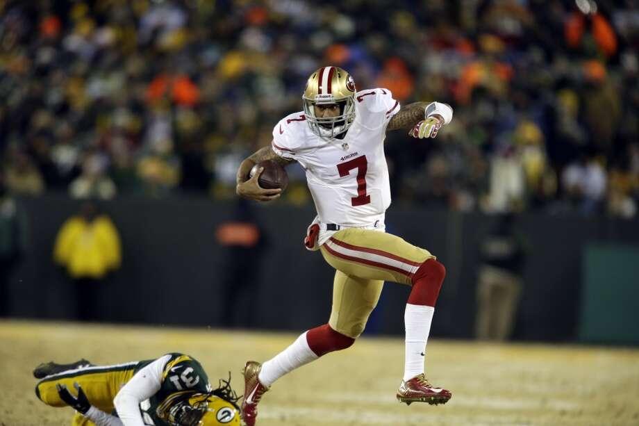 49ers quarterback Colin Kaepernick (7) runs against the Packers defense. Photo: Jeffrey Phelps, Associated Press