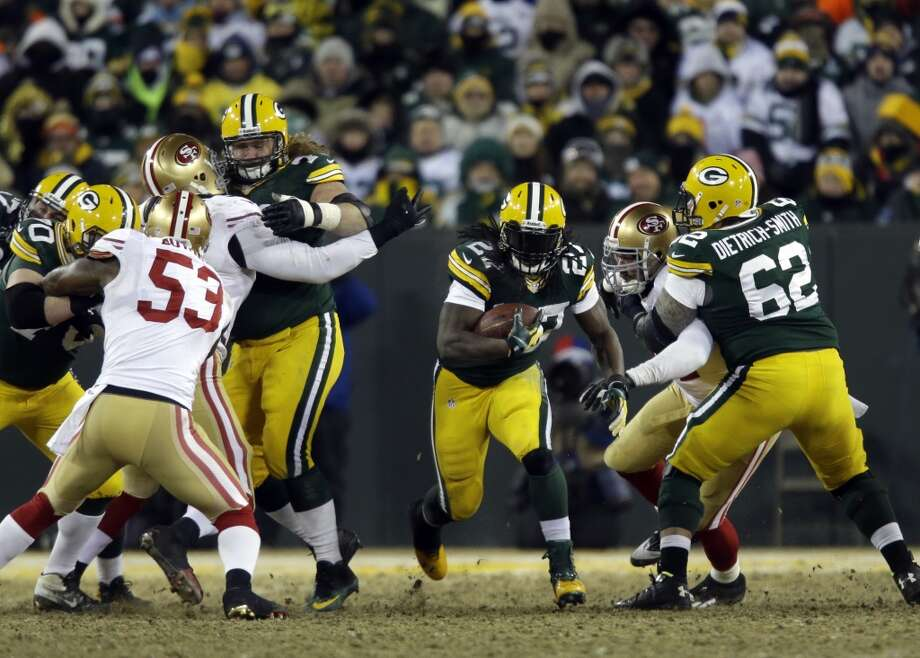 Packers running back Eddie Lacy (27) rushes against the 49ers defense. Photo: Jeffrey Phelps, Associated Press