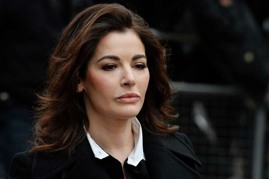 (FILES) In this file picture taken on December 4, 2013 British television chef Nigella Lawson arrives at Isleworth Crown Court in west London, as she prepares to give evidence in a case in which her two personal assistants (Elisabetta and Francesca Grillo) are accused of defrauding her and former husband Charles Saatchi.  British police are reviewing evidence that celebrity chef Nigella Lawson took cocaine, they said on December 22, 2013. AFP PHOTO/BEN STANSALLBEN STANSALL/AFP/Getty Images ORG XMIT: 686 Photo: BEN STANSALL / AFP ImageForum