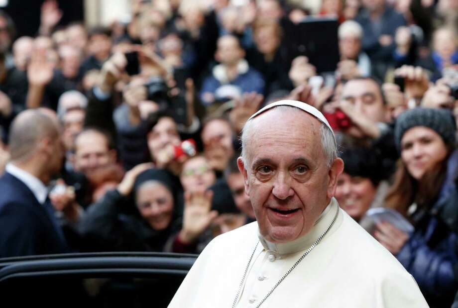 Pope Francis leaves Rome's Jesus' Church after celebrating a mass with the Jesuits, on the occasion of the order's titular feast, Friday, Jan. 3, 2014. (AP Photo/Riccardo De Luca) Photo: Riccardo De Luca, STR / AP