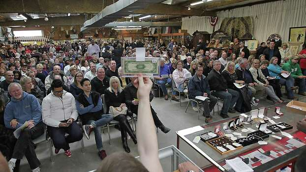 A U.S $500.00 dollar bill being auctioned off during the auction of the late Dr. Michael Brown's estate at Webster's Auction Palace Sunday, Jan. 5, 2014, in Houston.  The sale of his items are part of a bankruptcy case still in progress in U.S. District Court. Photo: James Nielsen, Houston Chronicle / © 2013  Houston Chronicle