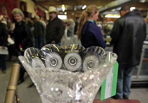 A hand cut crystal vase at the auction of the late Dr. Michael Brown's estate at Webster's Auction Palace Sunday, Jan. 5, 2014, in Houston.  The sale of his items are part of a bankruptcy case still in progress in U.S. District Court. Photo: James Nielsen, Houston Chronicle / © 2013  Houston Chronicle