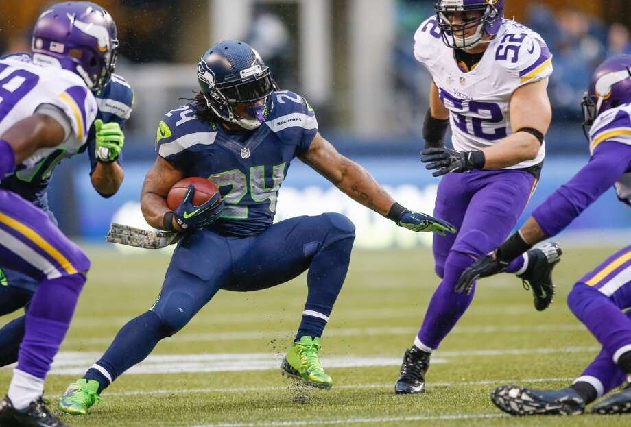 """Offensive MVP candidate: RB Marshawn LynchSeventh season, Cal2013 stats:Rushing: 301 attempts for 1,257 yards (4.2 yards per attempt), 12 TDReceiving: 36 catches for 316 yards (8.8 yards per reception), 2 TD""""Beast Mode"""" turned in another solid season as the featured back in the Seahawks offense, grinding out over 1,200 yards for the third time in his Seattle career. The team's offensive line woes showed up in his yards-per-carry average (down nearly an entire yard from 5.0 last season), but Lynch proved he still has a nose for the end zone, tying Kansas City's Jamaal Charles for the league-lead in touchdowns this season. He also made a greater impact receiving the ball than in any of his prior seasons in Emerald City.The Hawks offense sputtered on days when they couldn't establish Lynch on the ground, which underlines his importance to the squad. But perhaps his most significant contribution is the manner in which he plays: running in a brash, punishing style that provides the offense with an attitude and identity. Photo: Otto Greule Jr, Getty Images"""
