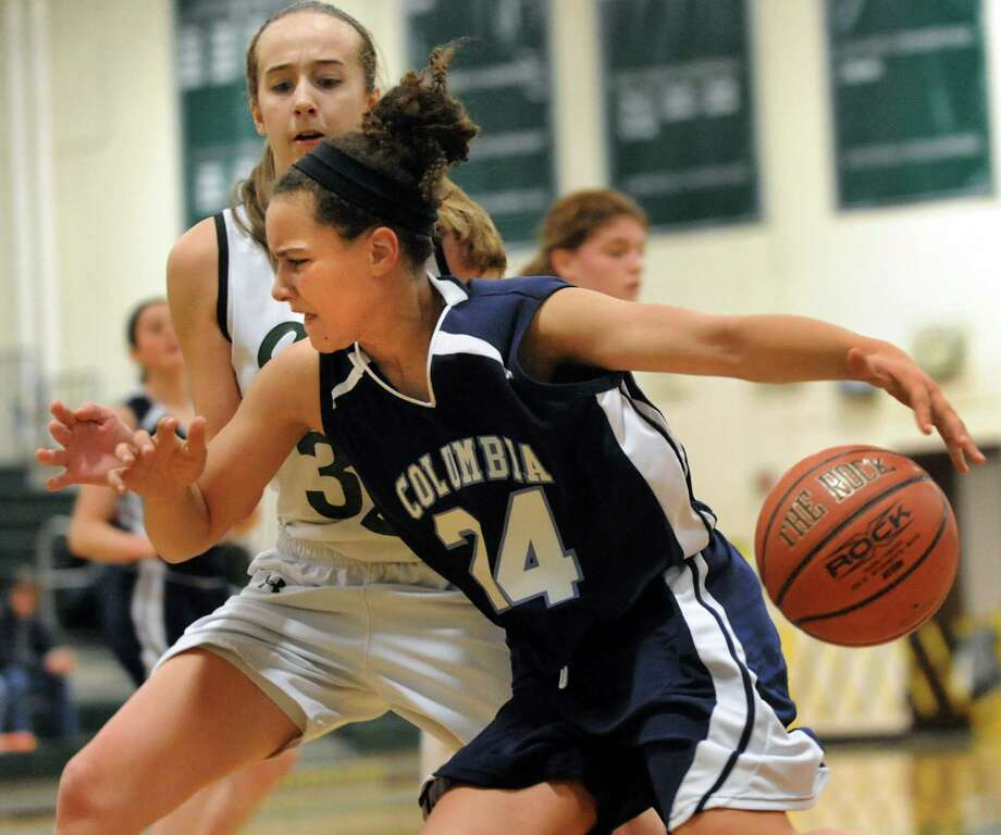 Columbia's Selena Lott, center, controls the ball as Shenendehowa's Carly Boland defends during their basketball game on Saturday, Jan. 4, 2014, at Shenendehowa High in Clifton Park, N.Y. (Cindy Schultz / Times Union) Photo: Cindy Schultz / 00025247A