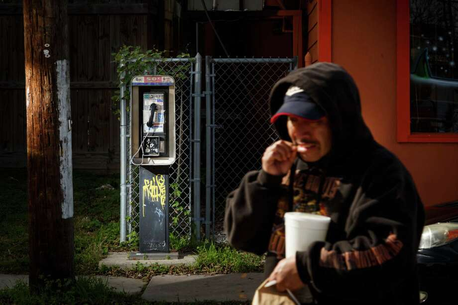 The pay phone next to Laredo Taqueria on Washington Avenue averages 1.5 calls a day but was once a hub in the evolving Magnolia Grove neighborhood where it has stood for 15 years. Photo: Michael Paulsen, Staff / © 2014 Houston Chronicle