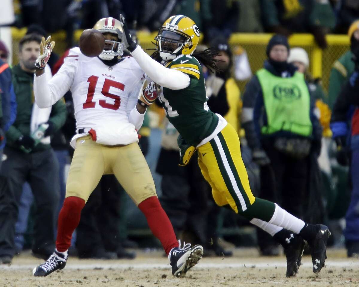 San Francisco 49ers wide receiver Michael Crabtree (15) makes a catch against Green Bay Packers cornerback Davon House (31) during the first half of an NFL wild-card playoff football game, Sunday, Jan. 5, 2014, in Green Bay, Wis. (AP Photo/Jeffrey Phelps)