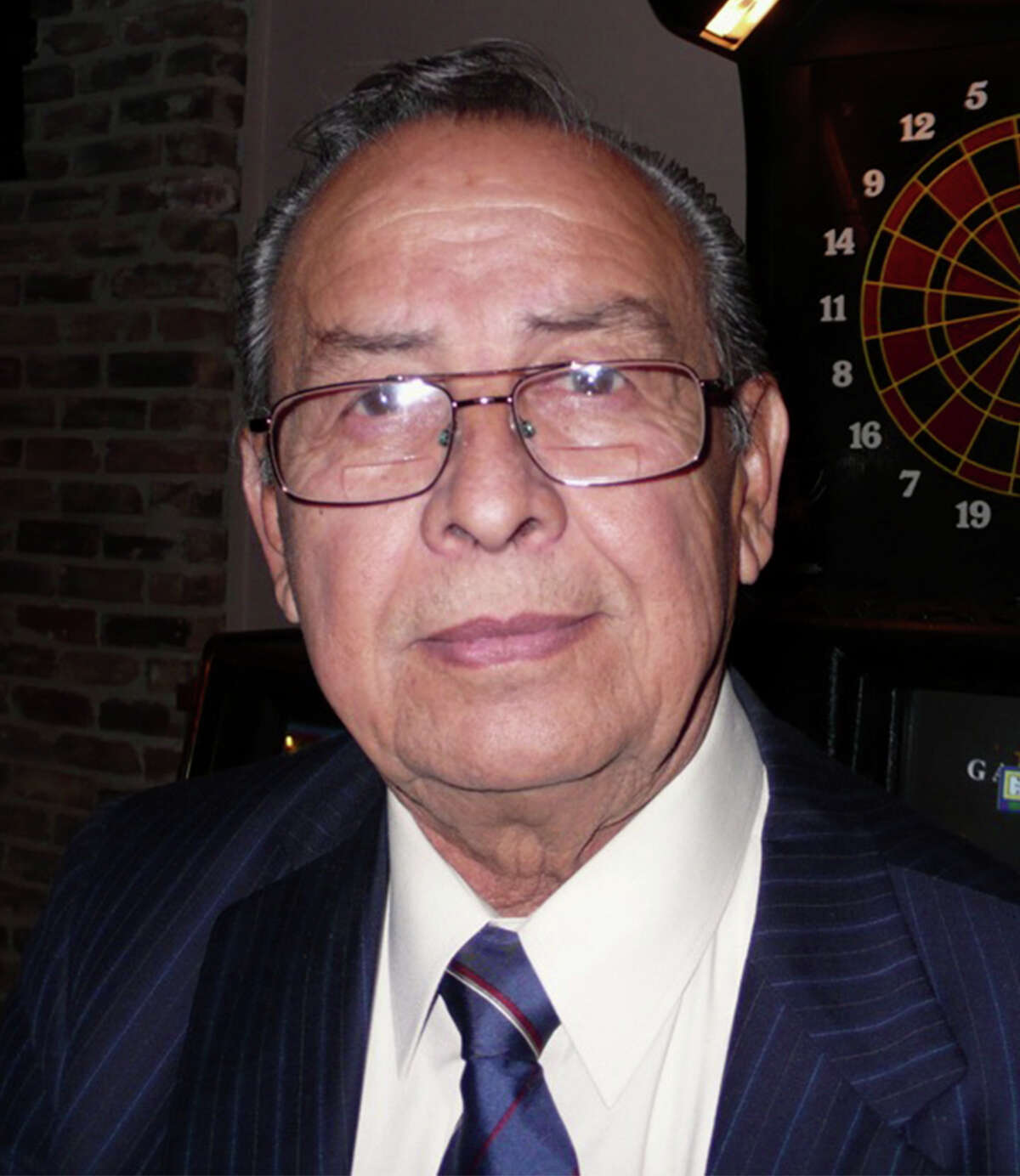 """Ray Madrigal, 71, of Corpus Christi, is a candidate for governor in the March 4 Democratic primary. The part-time municipal court judge in the tiny coastal town of Seadrift is the lone primary opponent to heavily-favored gubernatorial candidate Wendy Davis. Heé¢Ã©""""é´s shown in San Antonio campaigning at a Bexar County Democratic Party event on Dec. 17."""