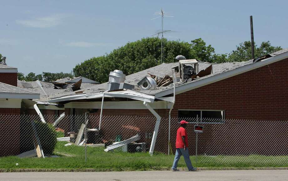 A man walks past the West Rest Haven nursing home, one of many buildings damaged in West's deadly fertilizer plant explosion. Photo: James Nielsen, Staff / © 2013  Houston Chronicle