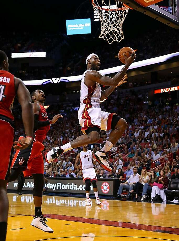 LeBron James takes to the air to give Miami a lift on his way to 30 points against Toronto. Photo: Mike Ehrmann, Getty Images