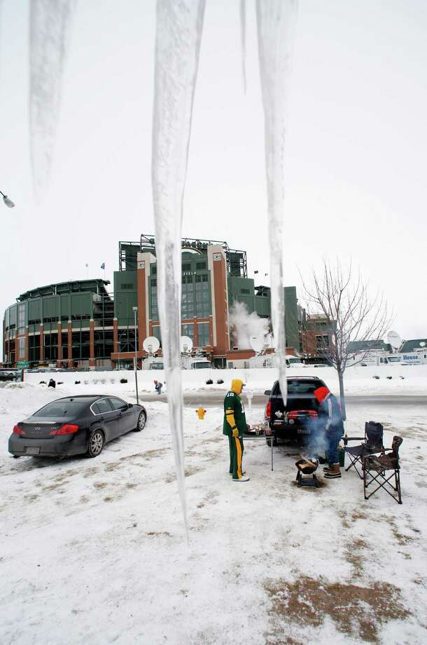Icicles are seen outside Lambeau Field as fans tailgate before an NFL wild-card playoff football game between the Green Bay Packers and the San Francisco 49ers, Sunday, Jan. 5, 2014, in Green Bay, Wis. (AP Photo/Jeffrey Phelps)  ORG XMIT: CAMG104 Photo: Jeffrey Phelps / FR59249 AP