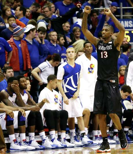San Diego State's Winston Shepard celebrates as the Kansas bench and fans deal with the end of KU's 68-game home win streak in non-conference games. Photo: Charlie Riedel, STF / AP